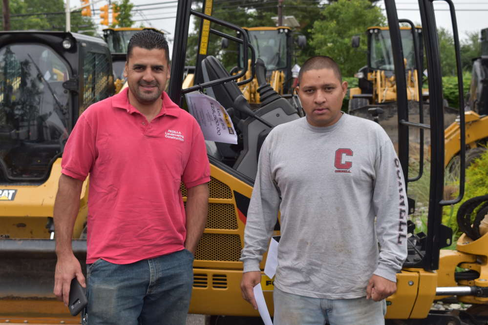 Franklin Padilla (L), owner, and Marcel Garcia, foreman, both of Padilla Landscaping Construction.