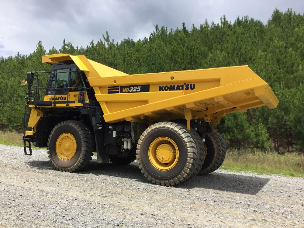 Komatsu's HD325-8 off-highway trucks are equipped with an EPA Tier IV Final certified engine and feature increased horsepower and a new Komatsu traction control system (KTCS) to achieve improved productivity. This model has a payload capacity of 40.3 tons (36.5 t) and  replaces the HD325-7.