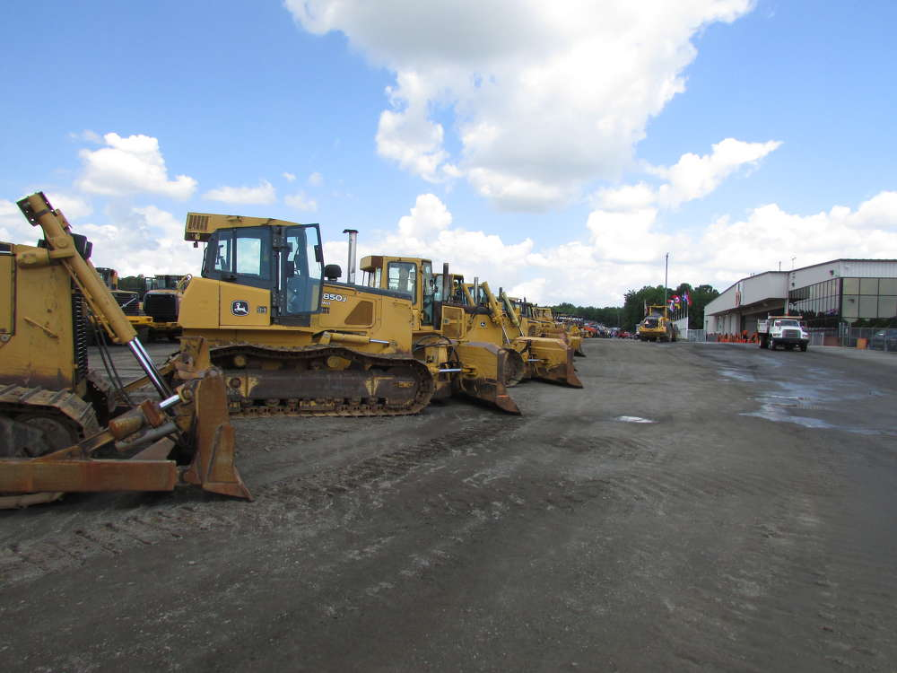 A line of dozers were ready to go on the block.