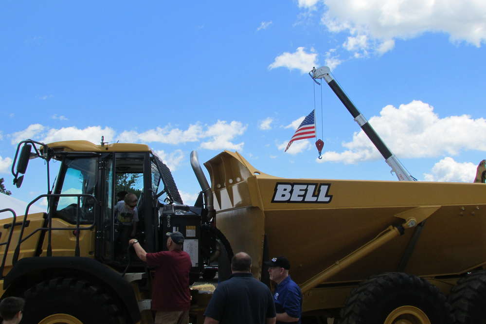 The American flag flies over a Bell truck at the open house.
