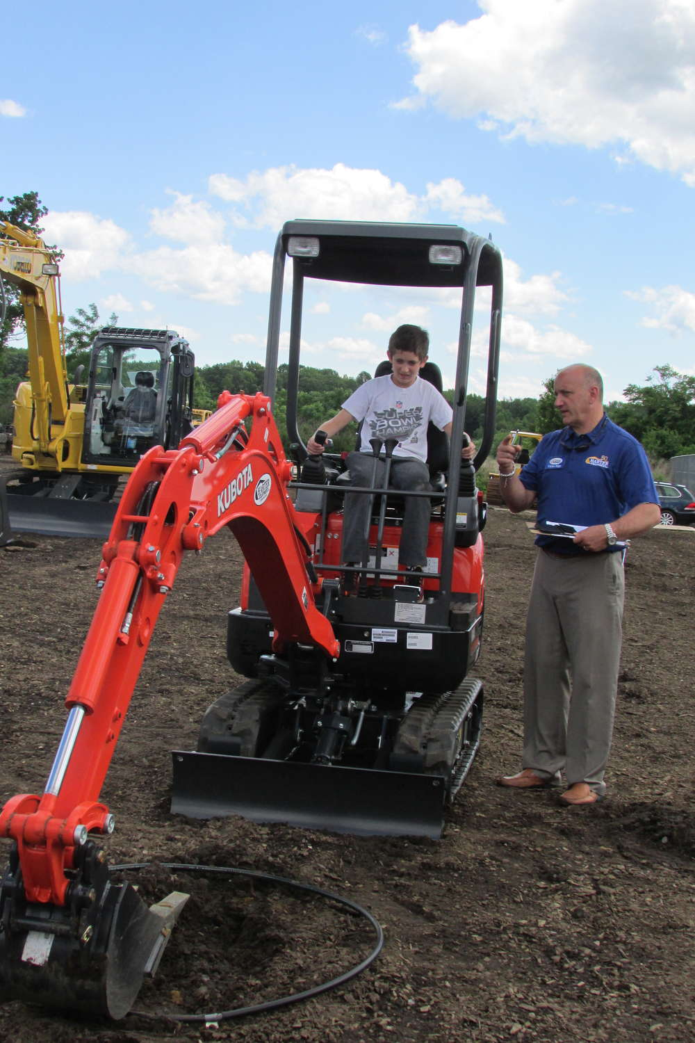 Vic Riga, vice president of sales, Harter Equipment, provides instructions for the children's rodeo during the open house.
