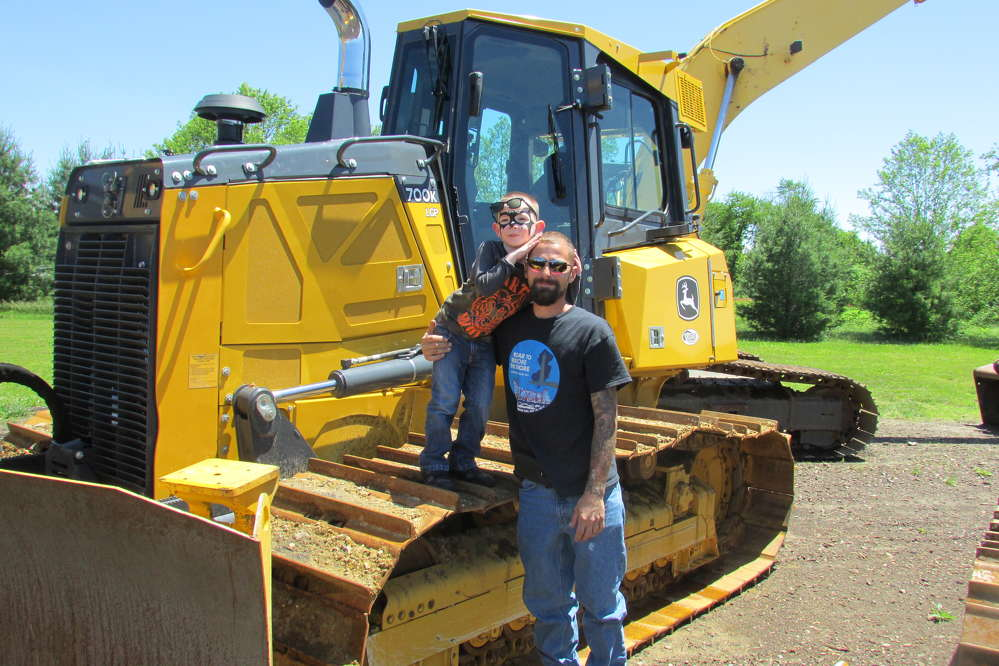 Mike Molchan of MRM & Son Services, Millstone, N.J., and his son, Mike Jr., enjoy the day together at Harter Equipment's 50th anniversary celebration.