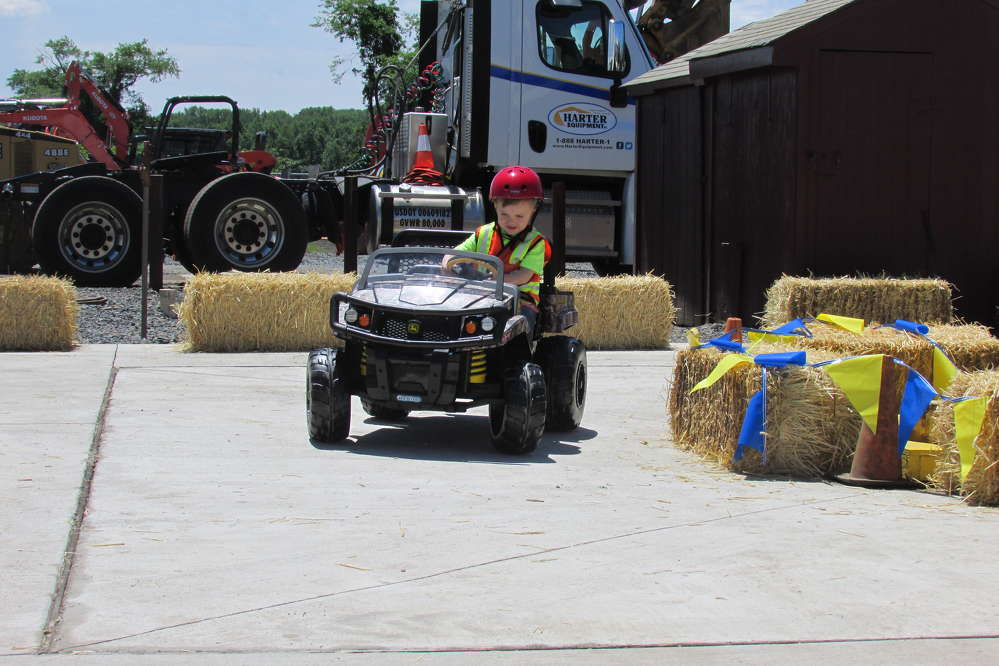 There were plenty of activities for the younger guests to enjoy. Here, Dean Pepkowski, grandson of Harter Equipment employee Helen Goodwin, races around the Gator track.