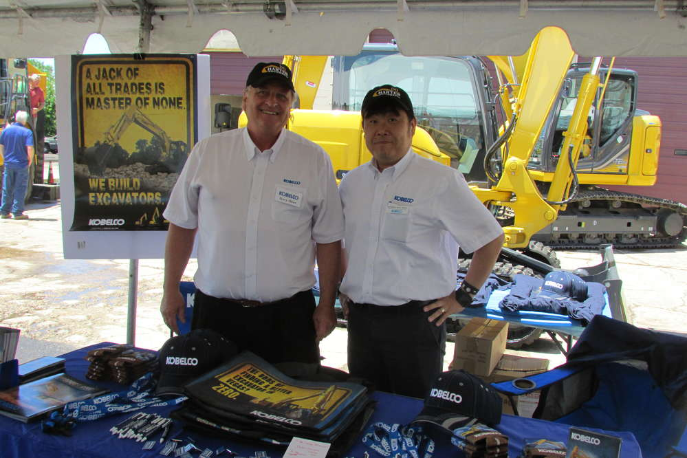 """Terry Ober (L), district business manager, and Katsuhiko """"Pete"""" Morita, vice president, head of excavator division, both of Kobelco, were busy speaking with guests throughout the four-hour event."""