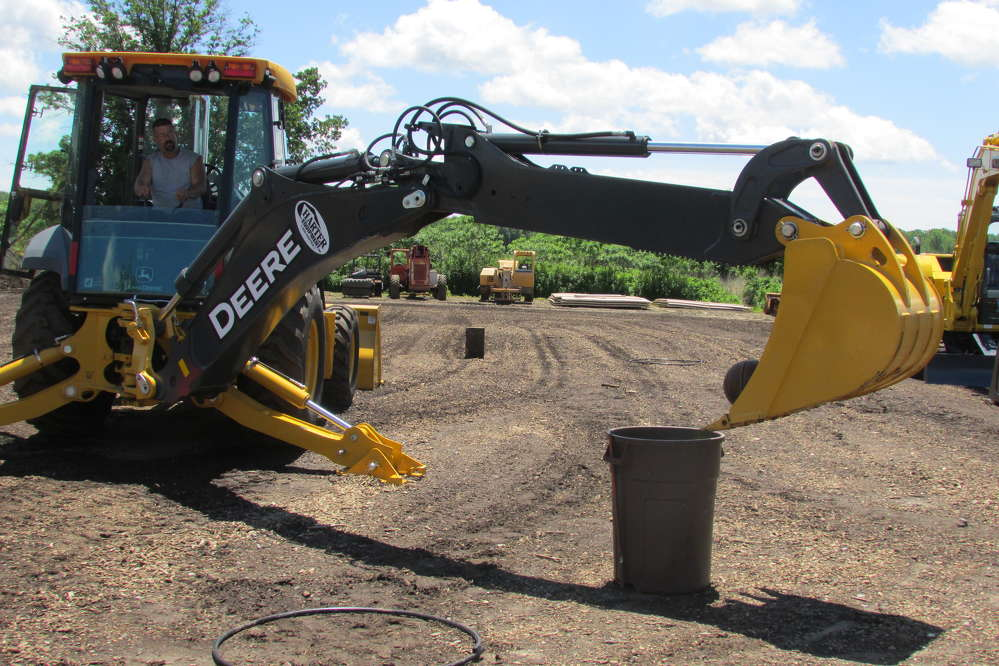 Playing some backhoe basketball is Joe Brenner of Brenner Drainage and Excavating, Monroe Township, N.J.