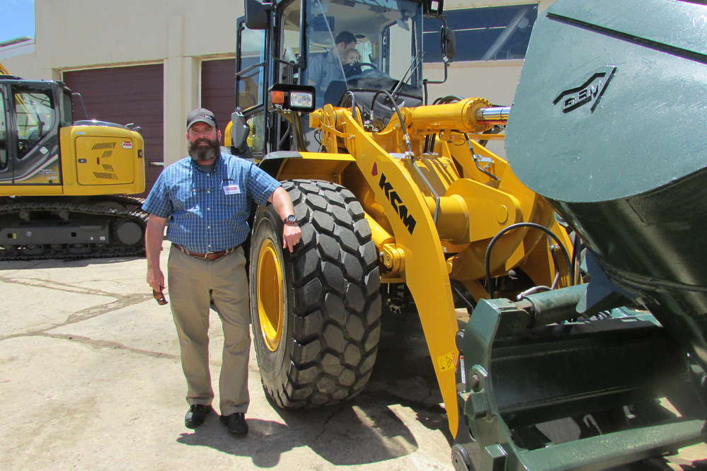 Drew Braun, regional sales manager of KCM, was eager to tout his company's line of wheel loaders during the event.