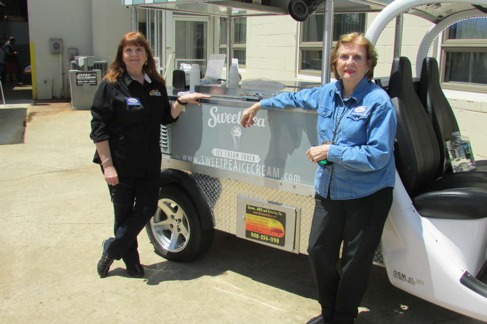 Sue Harter (L), president, and her mother, Judy Harter, wife of late founder Seth Harter, enjoyed meeting with customers and friends during Harte Equipment's 50th Anniversary Open House.