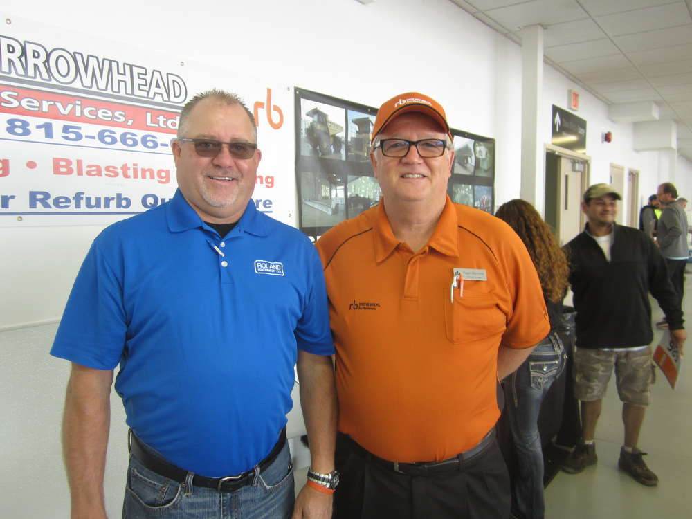Jay Germann (L), used equipment manager, Roland Machinery Co., and Roger Martinez, Ritchie Bros.