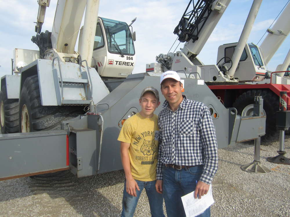 The father and son team of Kip (L) and Ryan Hoerr, both of Hoerr Machinery LLC, inspect this Terex RT 665 crane.