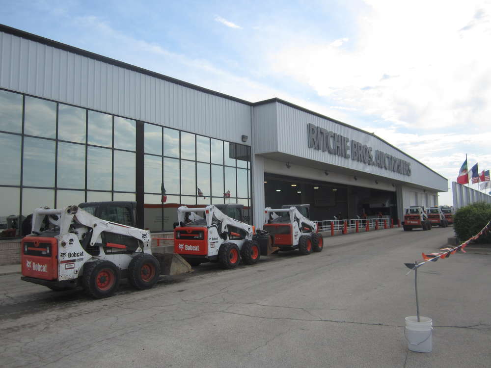 Bobcat skid steers line up to go over the auction ramp at the May 26 sale in Chicago.