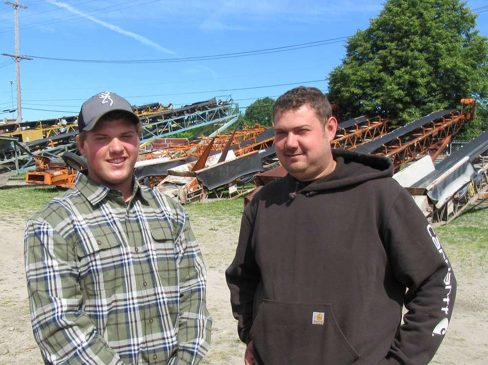 Nathan Moderalli (L) and CR Morjock of Moderalli Excavating had their eyes on a Eagle crusher up for bid at the sale.