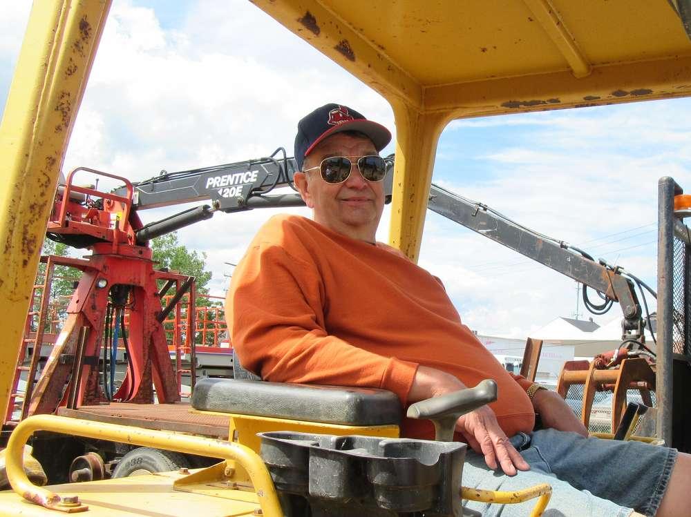 Ken Jones of Jones Farms takes in the auction activities.