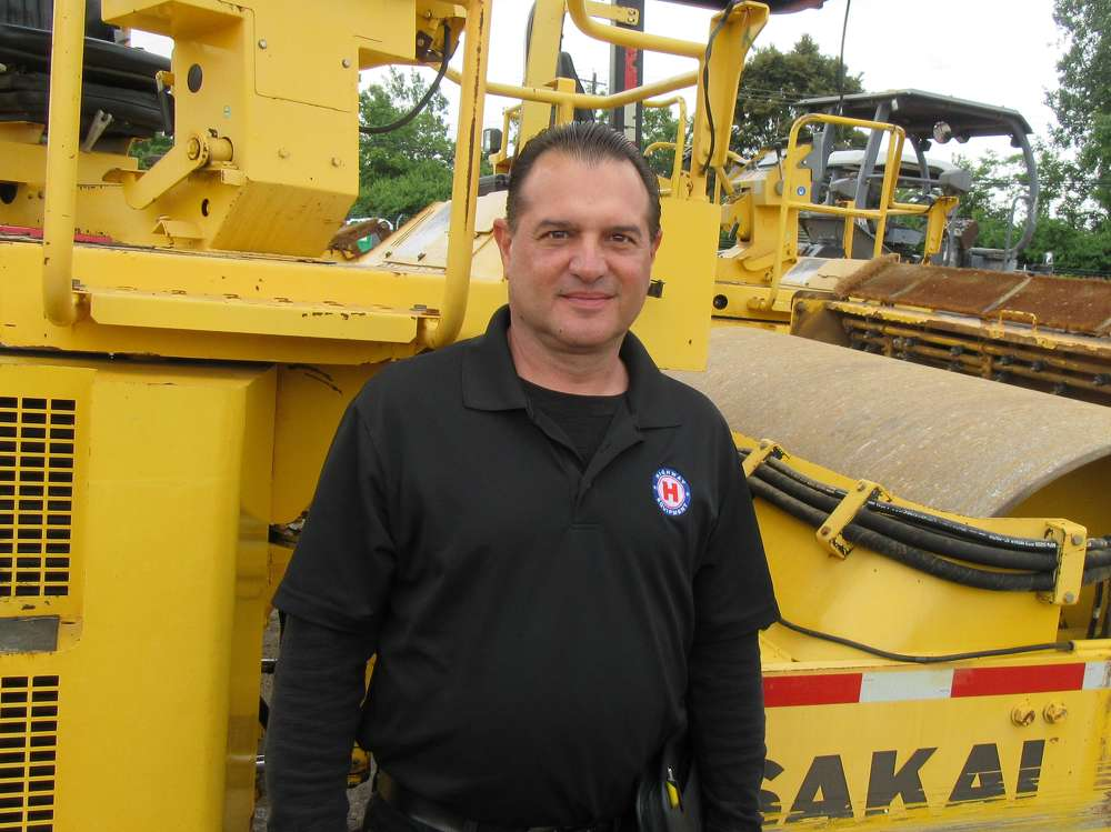 Don Risko, Highway Equipment Company service manager, stopped in to catch up with customers at the auction.