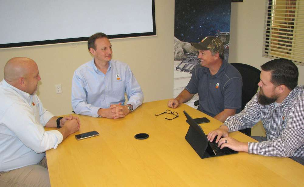 Edwin McCain (Second from R) participates in a recent planning meeting at the company's headquarters in Flowery Branch, Ga., (L-R) with Lee Smith, Giorgio Carera and Will Rigdon, all of FAE USA Inc.