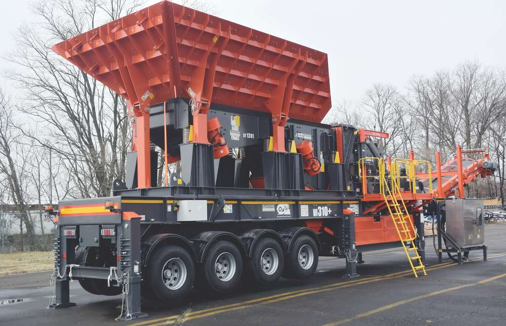 The Sandvik UI310+ offers a wheeled impact crusher mounted on a quad axle bogie.