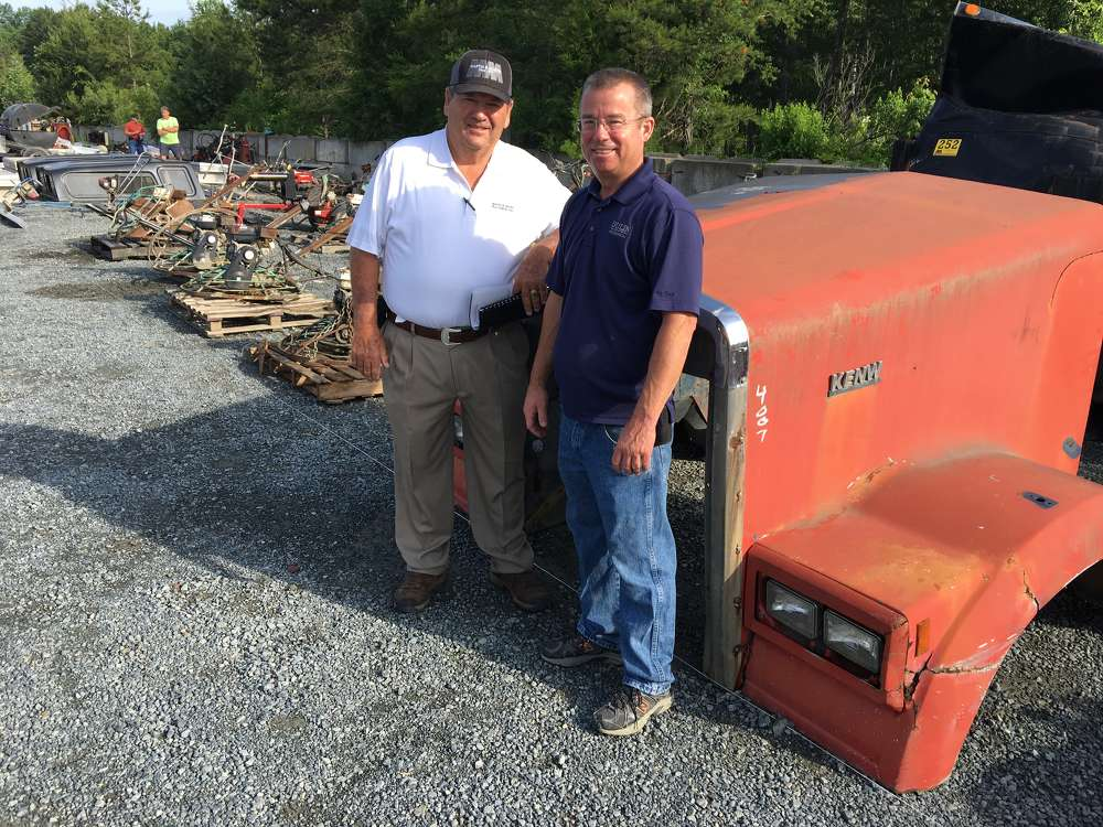 Paul Martin (L) welcomes Joey Dulin of Dulin Mechanical in Harrisburg, N.C., to the auction.