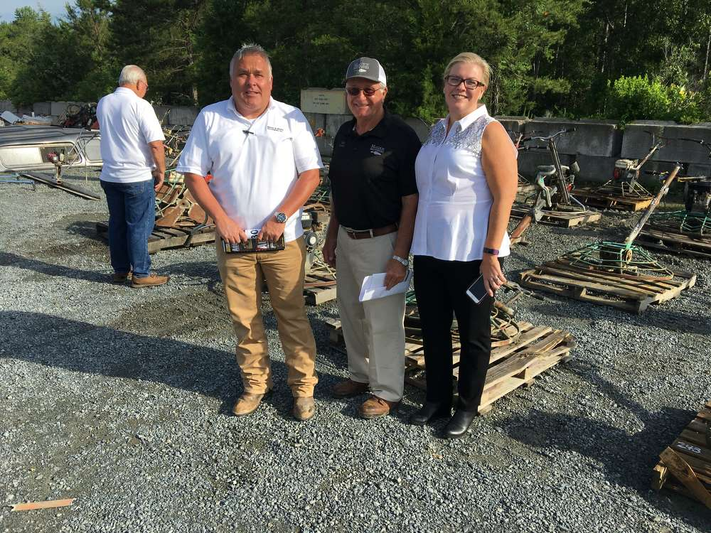 Matt McGaffee (L) and Jennifer Martin (R), both of Martin & Martin Auctioneers, talk with Mike McGee.