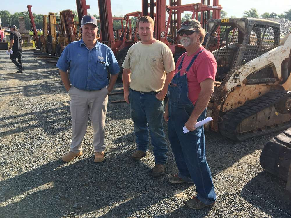 (L-R): Doc McGee and Kevin and Johnny West of T&J Farms in Aiken, S.C., show interest in the Bobcat track loaders.