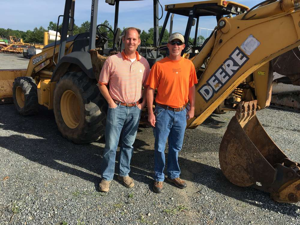 Timothy Griggs (L) of Griggs Forestry Services in Patrick, S.C., and Tony Parker of Parker Logging in Oakboro, N.C., shop the selection of backhoes and  logging equipment.