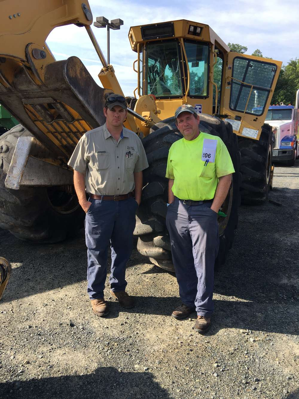 Evan Haigler (L) of River Island Inc. in Monroe, N.C., and Stuart Deaton of Old Dominion Timber in Ashland, Va., consider bidding on this Tigercat 610C machine.