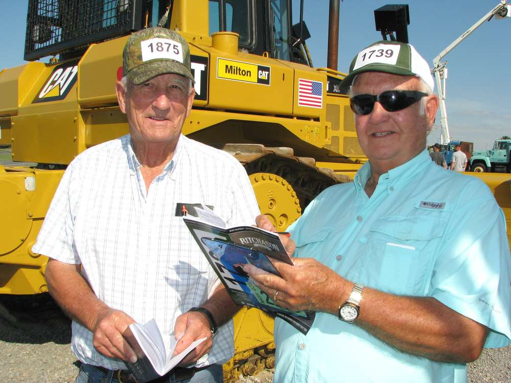 Dale Greer (L) of Columbia, Ky., and Jim Cassetty of Jim Cassetty Realtors, Hendersonville, Tenn., jot some notes on dozers of interest.