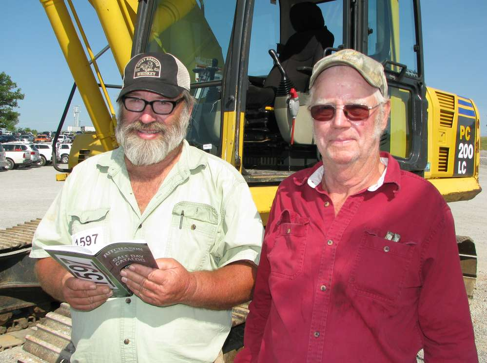 David Key (L) and Walter Stewart, both of Stewart Excavation, Gordonsville, Tenn., plan on a few of the excavators at the auction.