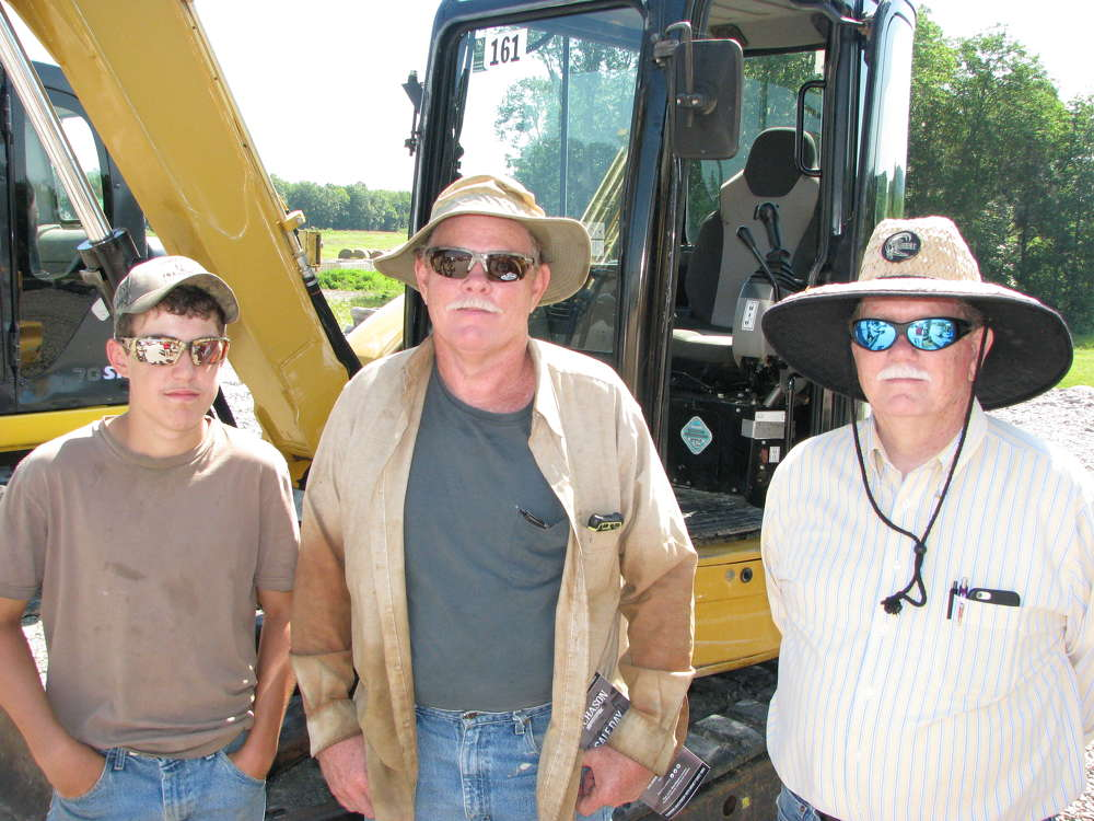 (L-R): John, Johnny and Roy Ayers, all of Ayers Construction, Nashville, Tenn., attend the sale.