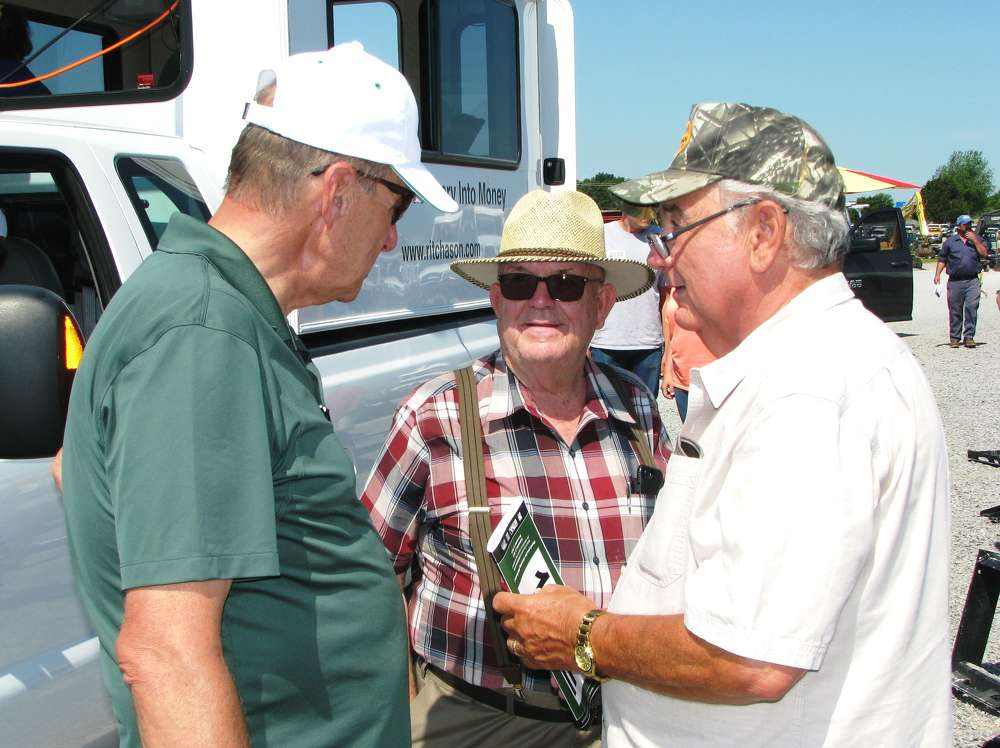 Dewain Ritchason (L), Ritchason Auctioneers, meets and greets his friends and customers,  including Willard Lowe,  Trucks & More Inc., Williamsburg, Ky., and Wayne Jean, retired farm and construction equipment dealer based in Fayetteville, Tenn.