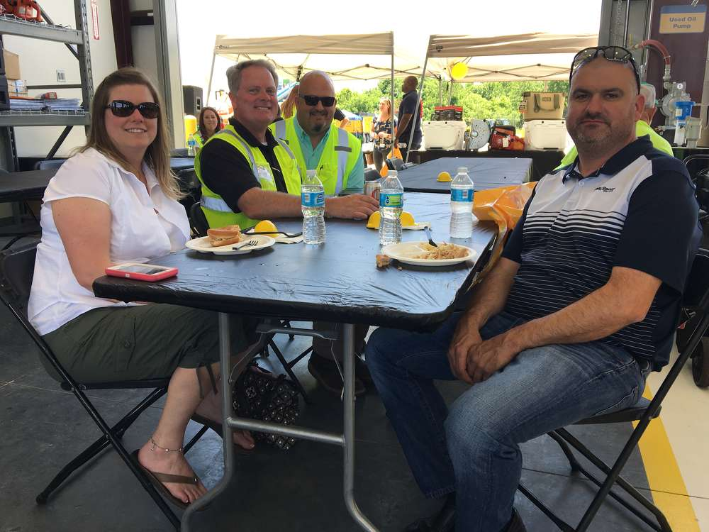 Rachel and Mark Letourneau (L-R, Front) both of Letourneau Enterprises in Charlotte, enjoyed the lunch and learning about the new facility from John Crocker (L) and Mark Kincer both of Carolina CAT.