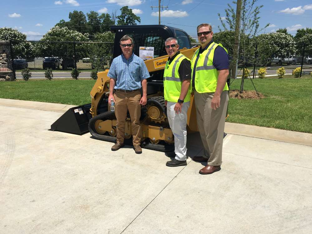 (L-R):Brian McMannus of Hoopaugh Grading Company in Charlotte, learns about the advances in the Cat 239D compact track loader from Tony Pennington and Mike Kunz, both of Carolina CAT.