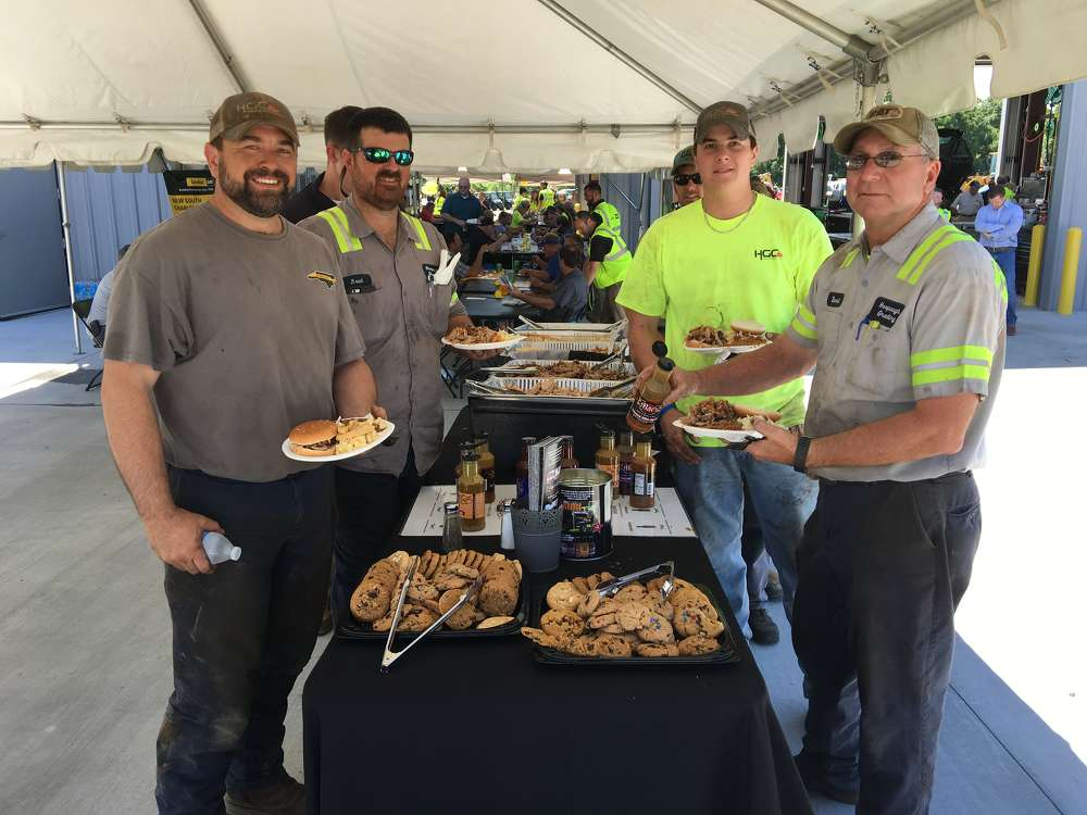 (L-R): Brian Murphy, Brad Caldwell, Braden McCarver and David Monroe, all of Hoopaugh Grading Company, enjoy a hearty lunch of pulled pork and chicken, coleslaw, baked beans and cookies.