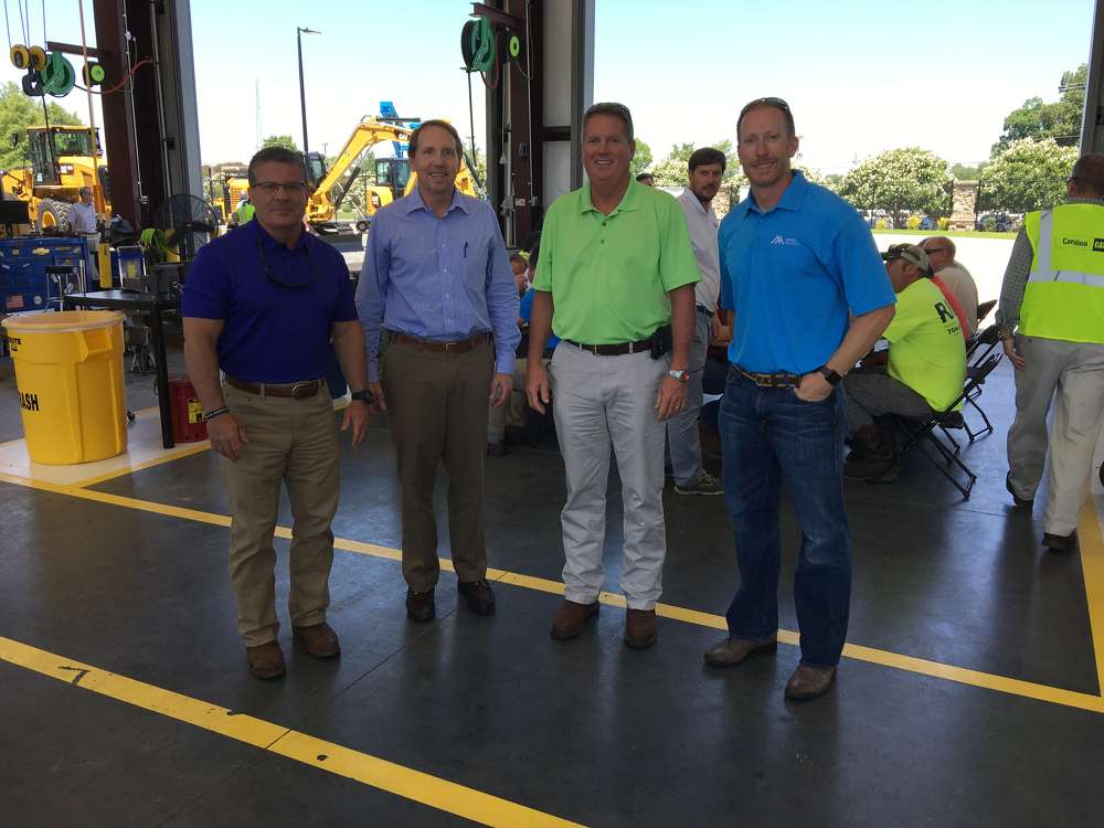 Ed Weisiger Jr., president of Carolina CAT, welcomes Jim Thompson, Dexter Tate and Brandon Lindsey, all of Martin Marietta in Charlotte, N.C.
