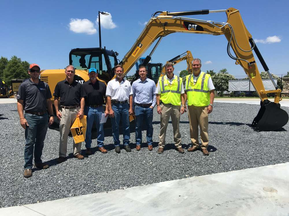 (L-R):?Daniel Wayne, Alan Goodman, Mike Henrickson, Jerry Lambert and Brandon Spears, all of Wayne Brothers in Charlotte and Neil Carbaugh and Mitch Christenbury, both of Carolina CAT, discuss the new facility.
