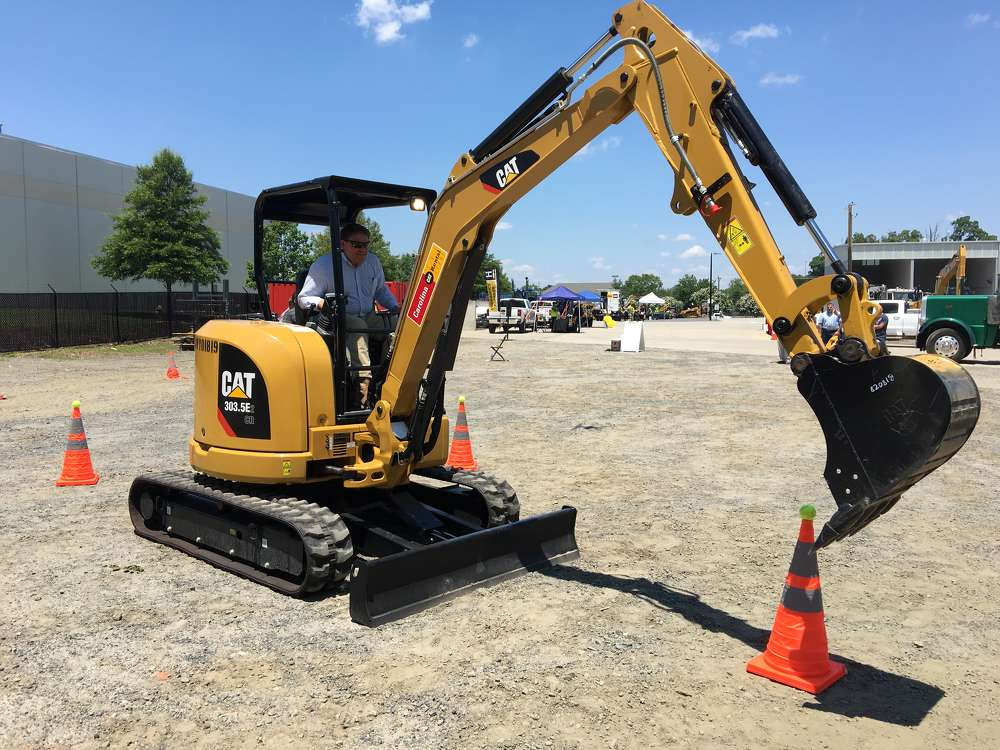 Sclater Heindl of Carolina Site in Charlotte tests out this Cat 303.5E 2 excavator during the operator contest.