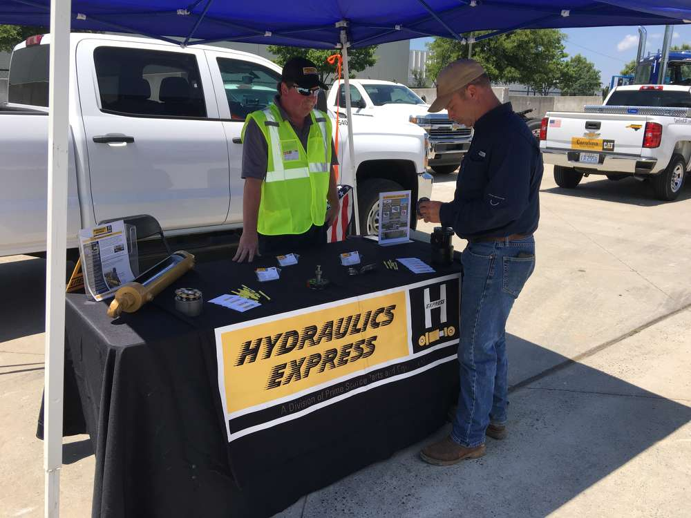 Bobby Tolley (L) of Hydraulics Express, a division of Carolina CAT, goes over the company's offerings with Charles Morgan Jr. of 5 Stones Grading Inc. in Charlotte.