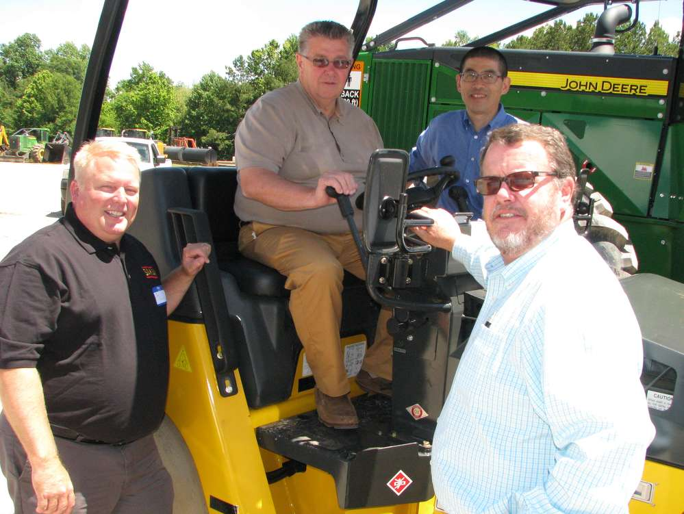(L-R) Joe Seckinger, Sakai; Joe Keenum, Joe Keenum Excavation and Construction, Muscle Shoals, Ala.; Yuki Tsukimoto, Sakai; and Bill Mitchell, Warrior Tractor, Athens, Ala., go over features and benefits of the machines.
