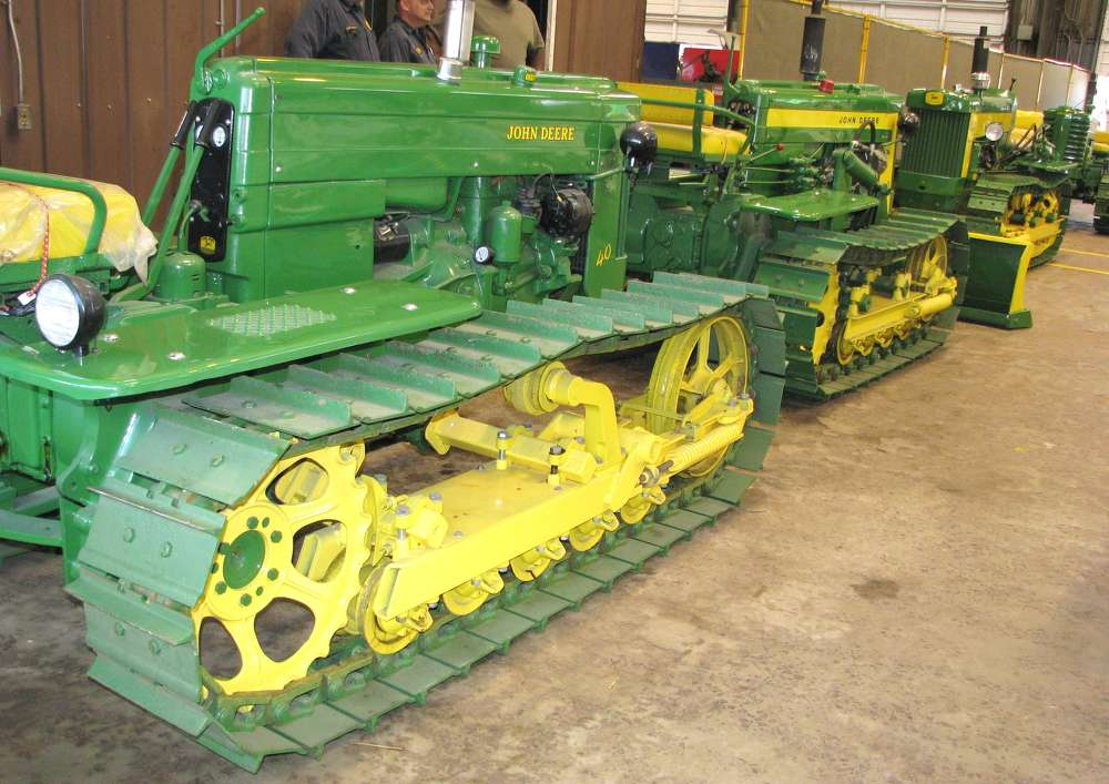 A display of fully restored 1950s model John Deere tractors were in the shop area.