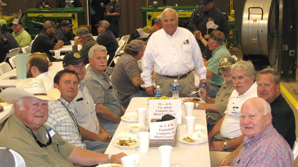 Gene Taylor (C), owner of Warrior Tractor, visits with a big group of guests, including (L-R) Ray Gore, Perma Corp., Columbus, Miss.; Vann Neal, Warrior Tractor; Matt Manning, Manning Construction; Kenny Robison, MS&R Equipment; Bob Silvers, AlaWest-WV Operation; Randy Robison, MS&R Equipment  & Cedar Lake Mining; Freddie Hunt, Cedar Lake Mining; and Wendell Shirley, Shirley Concrete.