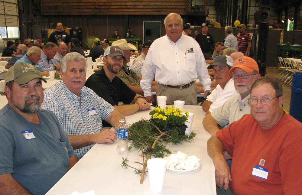 Gene Taylor (C), Warrior Tractor owner,  made the rounds to thank his customers for their business, including (L-R) R.D. Tyler, Silver Creek Logging; Roy Geiger and Mark Geiger, both of Sumter Timber; Morris Etheridge, Hamilton Timber; Craig Hare, Warrior Tractor; and Wayne Garrett, Fulton Logging.