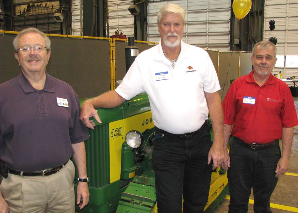 (L-R): Bill Waits, TAG Manufacturing, Chattanooga, Tenn.; Steve Rawls, Morbark, Winn, Mich.; and Jim Myers, Paladin Attachments, Ooltewah, Tenn., lend their support for the event.