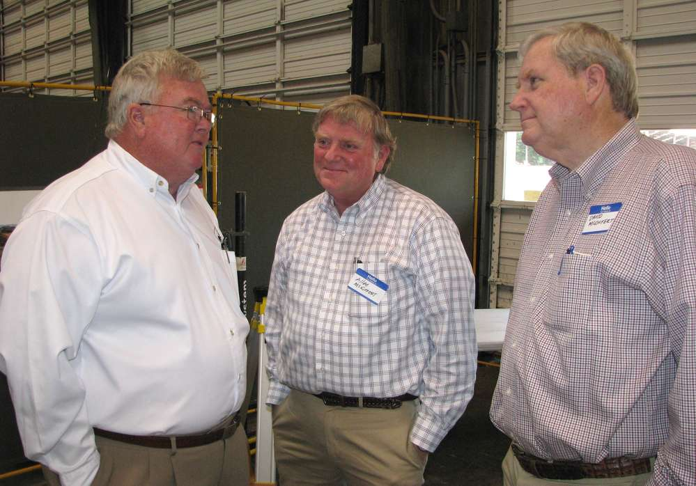 (L-R): Fred Colson, Warrior Equipment, and Allen McGiffert and David McGiffert, both of McGiffert & Associates Civil Engineers, Tuscaloosa, Ala., reminisce about the old days at Warrior Tractor.