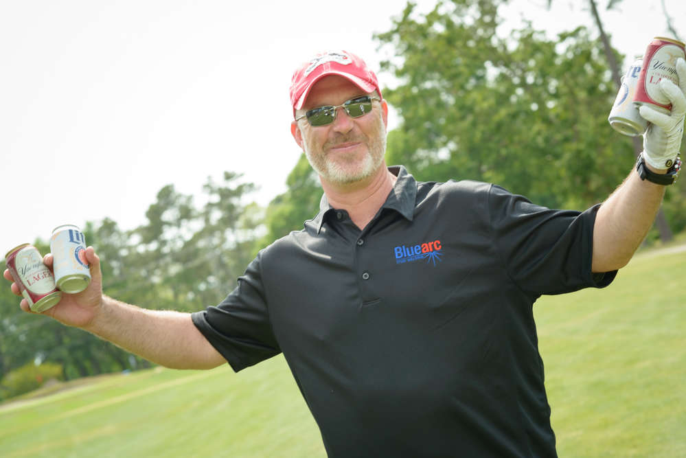 Duke Perry works behind the scenes on many of the association's events, including bringing beverages to fellow golfers during the annual golf tournament.