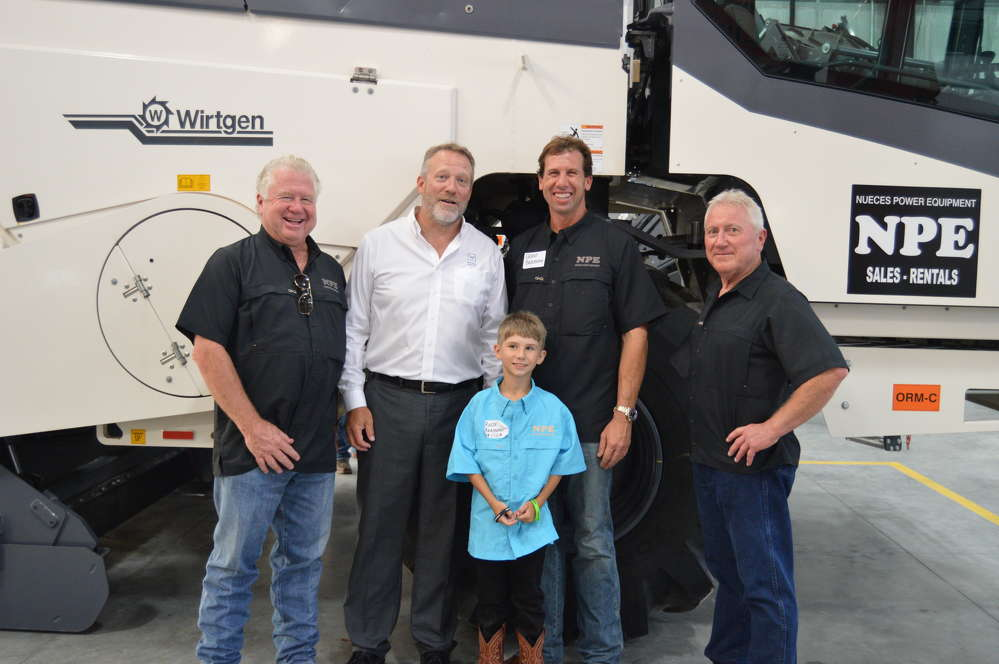 Happy with the success of the open house (L-R) are Clifton Bradshaw, owner of Nueces Power Equipment; Jim McEvoy, president of Wirtgen America; Reese Bradshaw, Clifton's grandson; Grant Bradshaw, Clifton's son; and Rodney Bishop, vice president at Nueces Power Equipment. (Brandi Muniz photo)