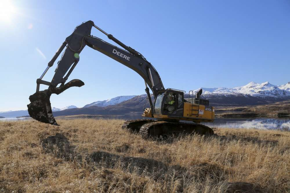 Arizona Guardsman Spc. Aaron Tellez, a motor vehicle operator with the 259th Engineer Platoon, operates an excavator 