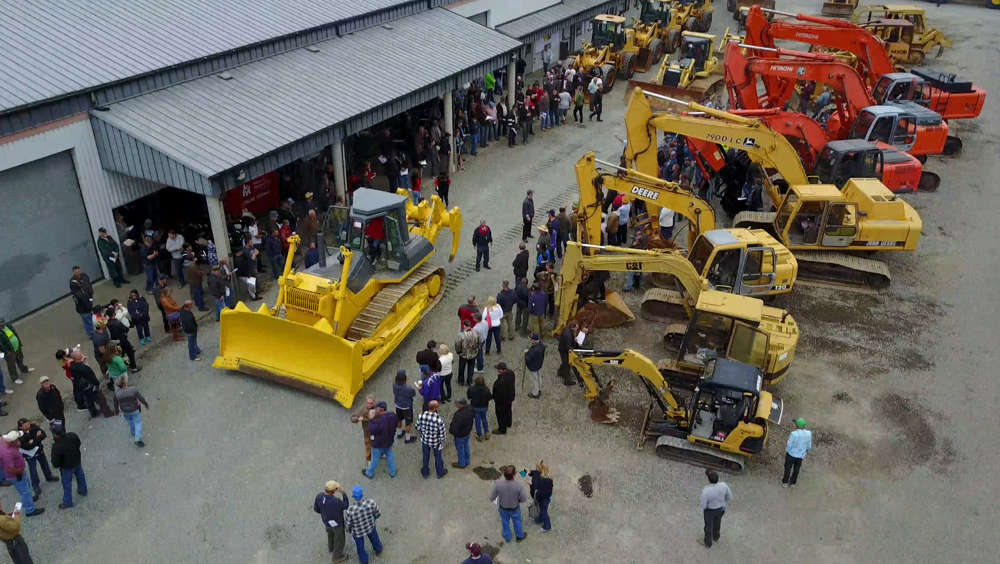 The crowd gathers to bid on a mix of heavy equipment that was up for auction on June 10.