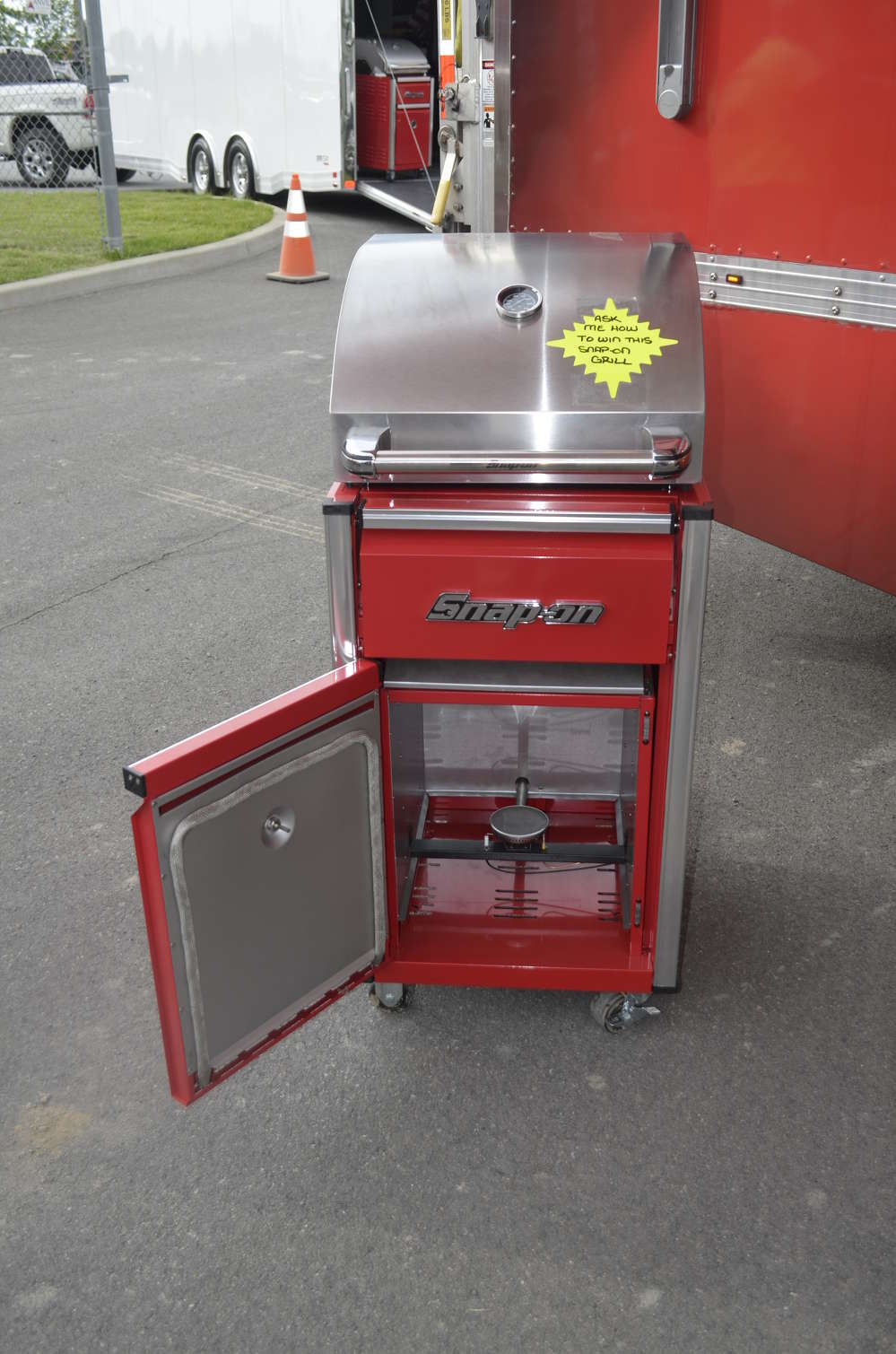 """Attendees have the opportunity to win this """"Snappy"""" Snap-On combination gas grill and smoker."""
