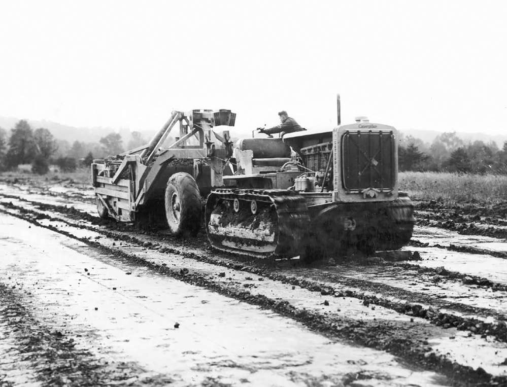 A Caterpillar RD-8 with a LeTourneau Carryall scraper is seen moving overburden at the site. (HCEA: R. G. LeTourneau Collection photo)