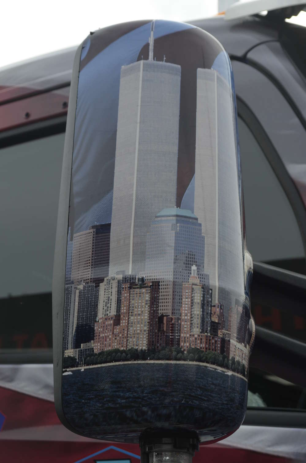 The images on the side mirrors recall what lower Manhattan's skyline looked like before the 9/11 attacks.