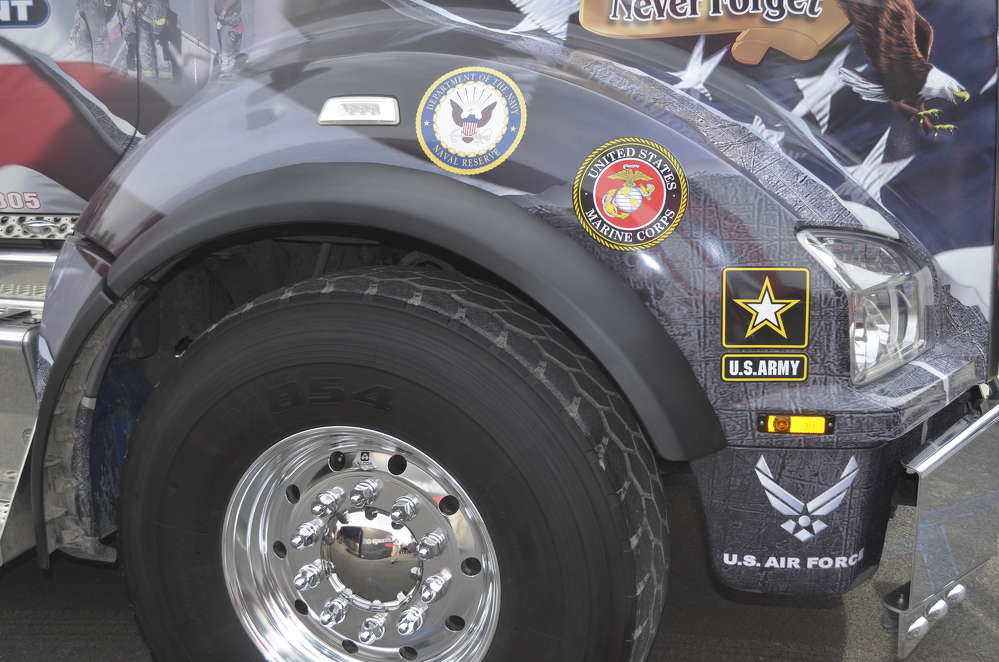 The logos of the branches of the U.S. military are emblazoned over the passenger side front wheel.