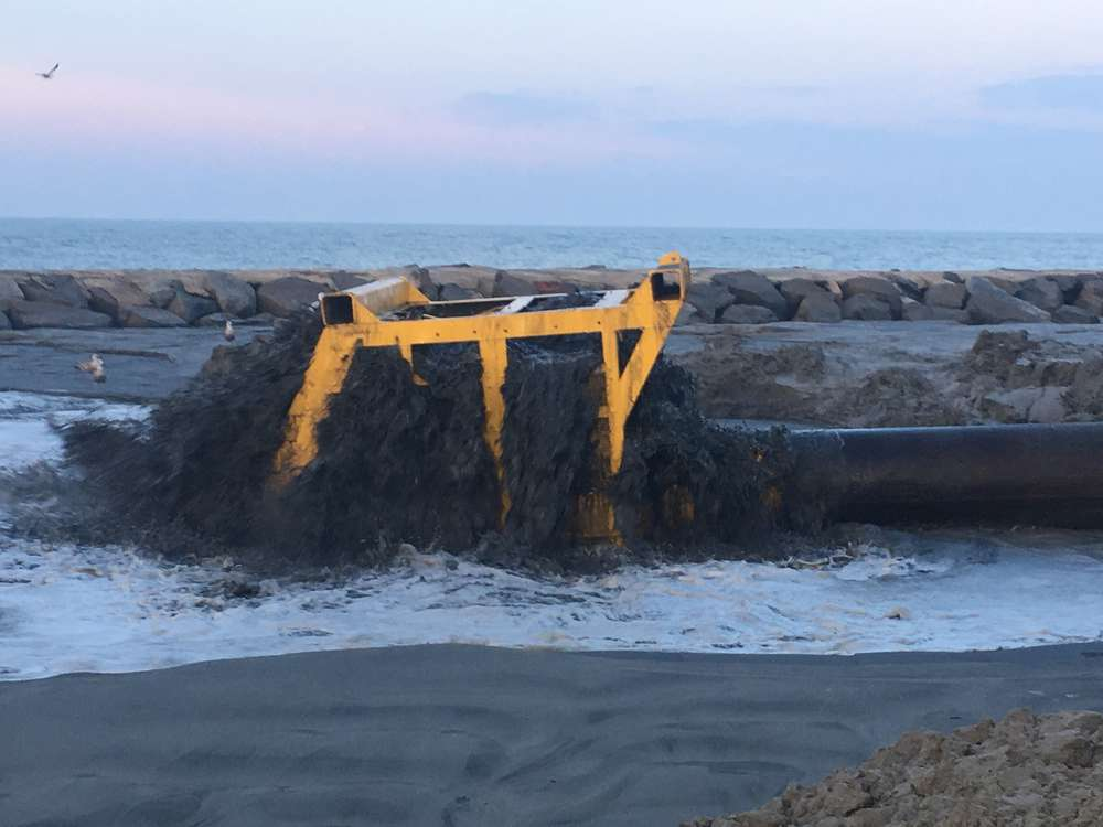 The Dredge CR McCaskill, owned and operated by Weeks Marine Inc., is being used to dredge material from Absecon Inlet and pump material onto the beach in Atlantic City, N.J.